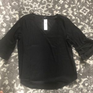 Black silk top with bell sleeves